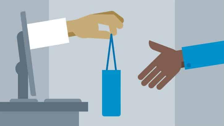 Hand giving a shopping bag through a computer screen | Online Video Marketing