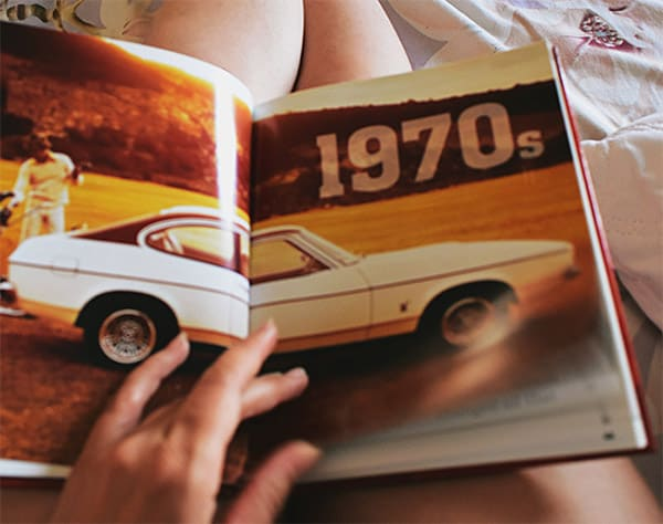 Reading vintage car magazine