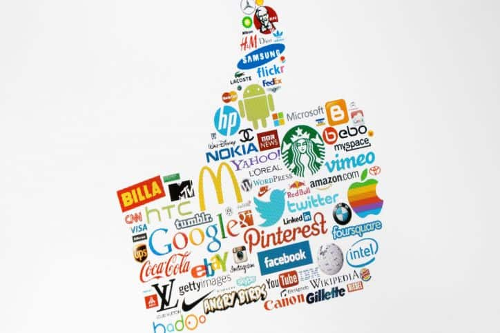 Thumbs up made with various big brand logos
