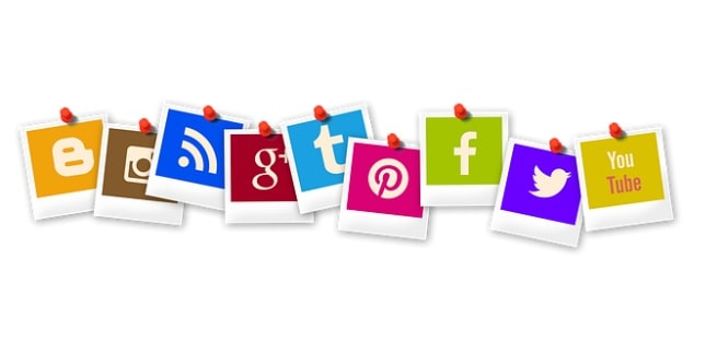 social media logo snapshots pinned to board