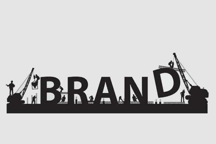 Building a Brand | Construction workers erecting brand lettering