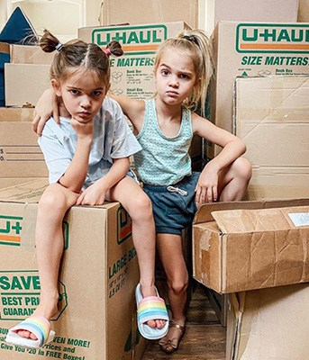 Gansta Pose on U-Haull Boxes | Emma Mila Stauffer