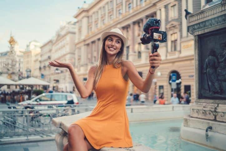 Influencer taking selfie in top travel location
