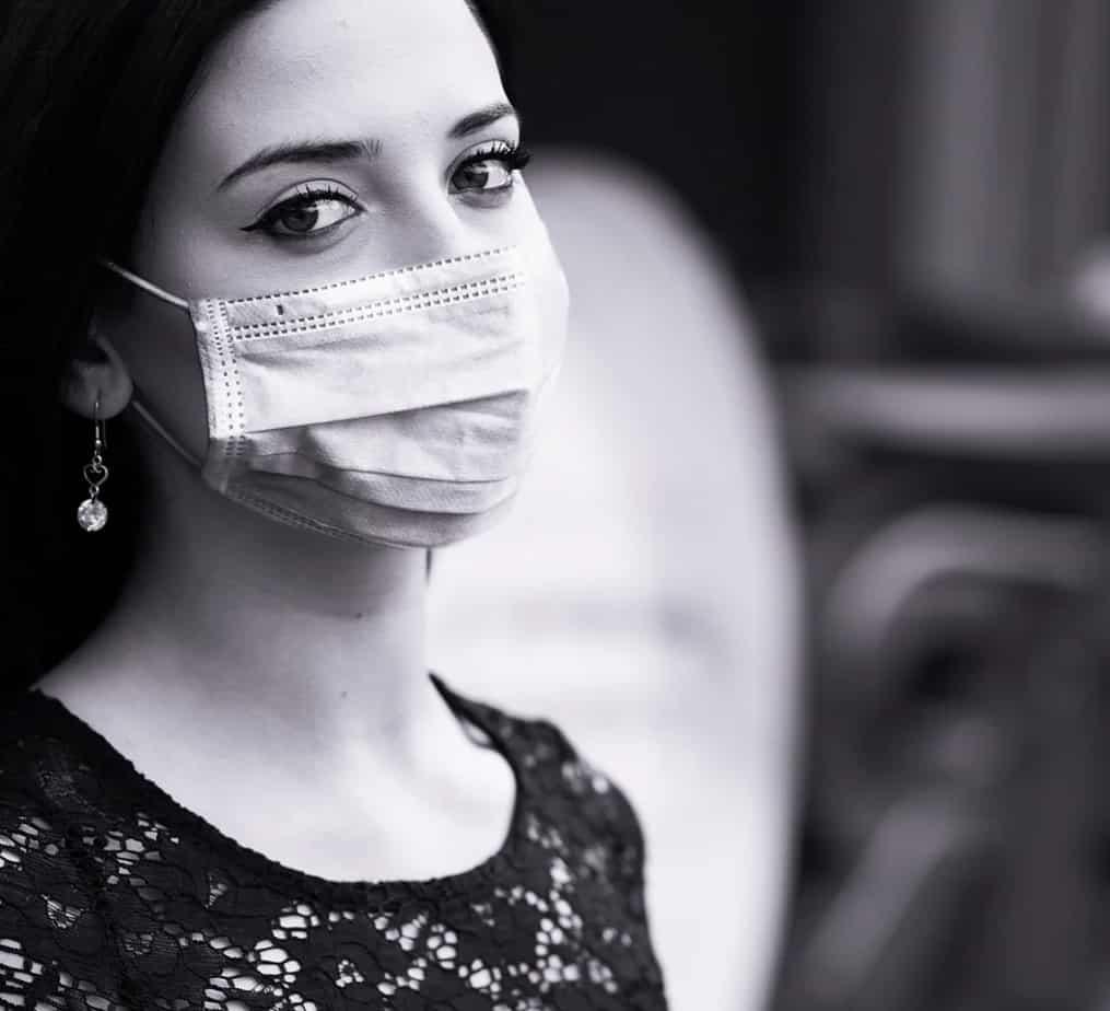 Influencer wearing mask to protect against coronavirus