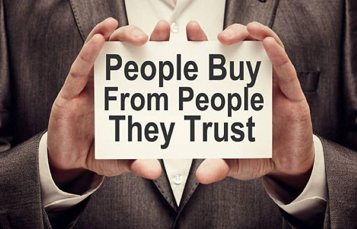 People Buy From People They Trust | man holding card