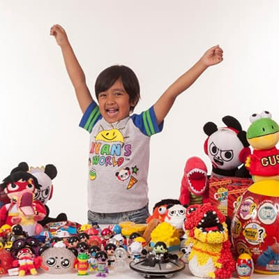 Famous Influencer under 10 surrounded by toys