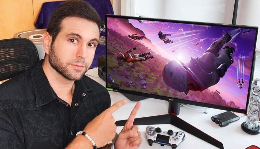 Vagetta777 pointing at his gaming monitor