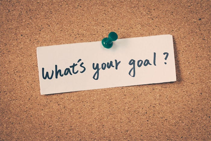 note on corkboard asking what's your goal